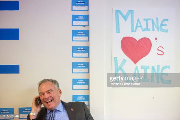 Senator Tim Kaine makes a phone call to a volunteer to thank them for their work at a Clinton Kaine campaign office in downtown Portland