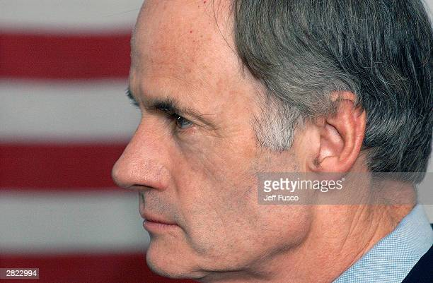 S Senator Tom Carper listens as US Sen and Democratic Presidential candidate Joseph Lieberman speaks at M Cubed Technologies on Decemeber 19 2003...