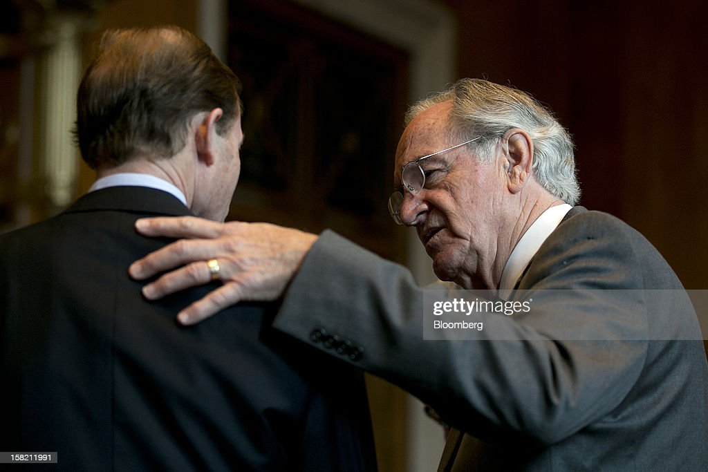 Senator Tom Harkin, a Democrat from Iowa, right, talks to Senator Richard Blumenthal, a Democrat from Connecticut, before a news conference conference in Washington, D.C. U.S., on Tuesday, Dec. 11, 2012. Democratic lawmakers want Medicaid funding protected in the fiscal cliff talks. Photographer: Andrew Harrer/Bloomberg via Getty Images