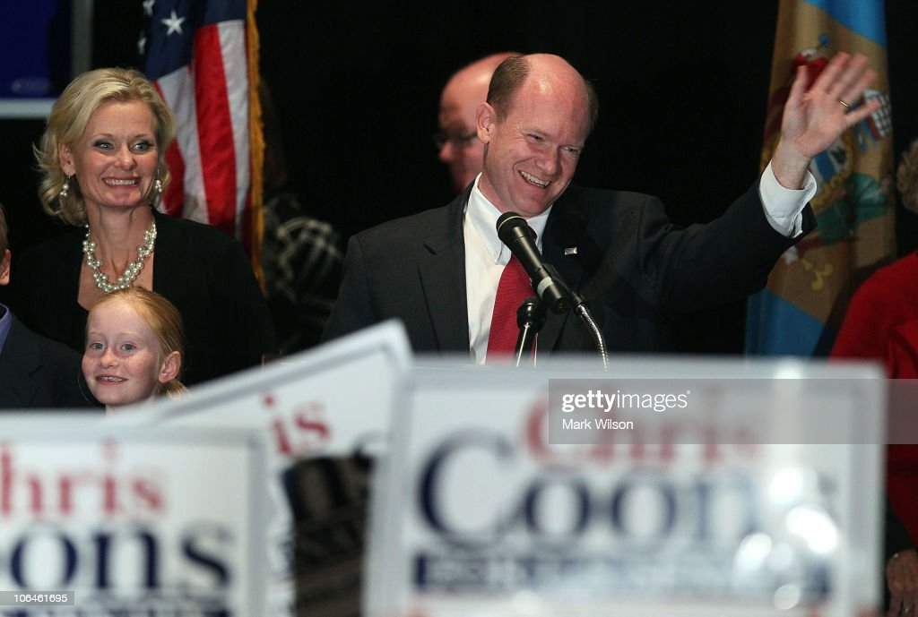 U.S. Senator-elect Chris Coons (D-DE) (R) celebrates with his wife Annie Coons during his victory party on November 2, 2010 in Wilmington, Delaware. Chris Coons beat out Republican challenger Christine O'Donnell to win Vice President Biden's old Senate seat.