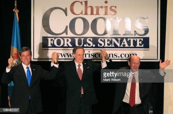 S Senatorelect Chris Coons stands with Sen Tom Carper and Representativeelect John Carney during his victory party on November 2 2010 in Wilmington...