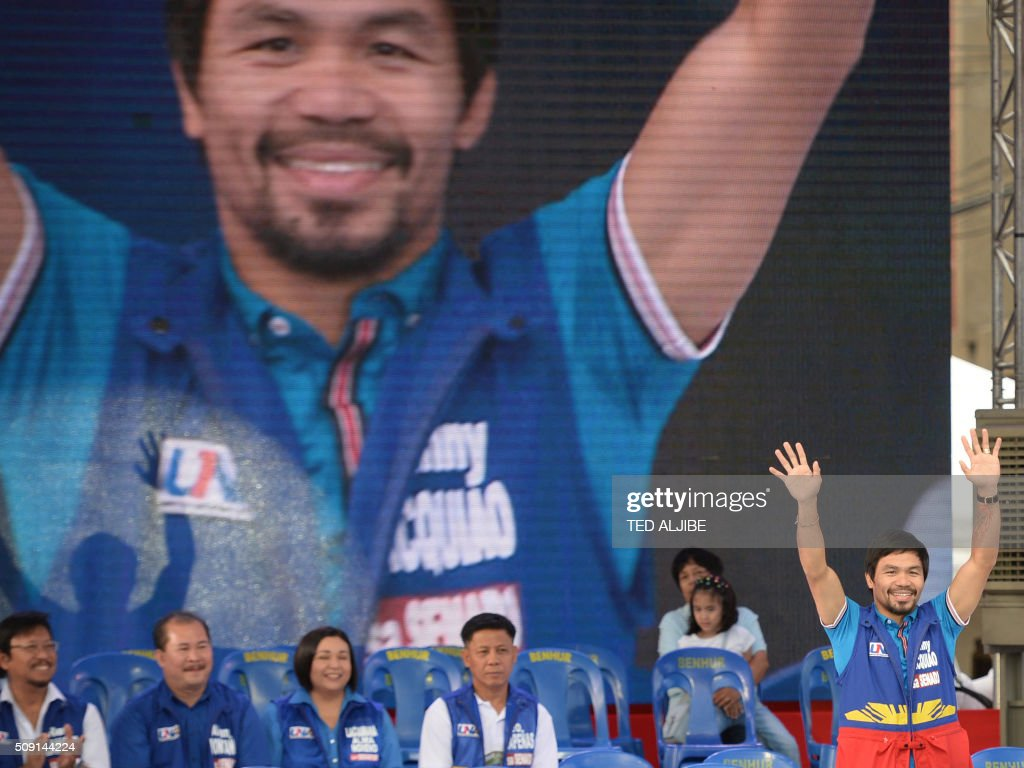 Senatorial candidate of the opposition party and boxing icon Manny Pacquiao (R) greets supporters during his party's proclamation rally in Manila on February 9, 2016. A cliffhanger race to lead the Philippines began February 9 with the adopted daughter of a dead movie star and a tough-talking politician who claims to kill criminals among the top contenders. AFP PHOTO / TED ALJIBE / AFP / TED ALJIBE