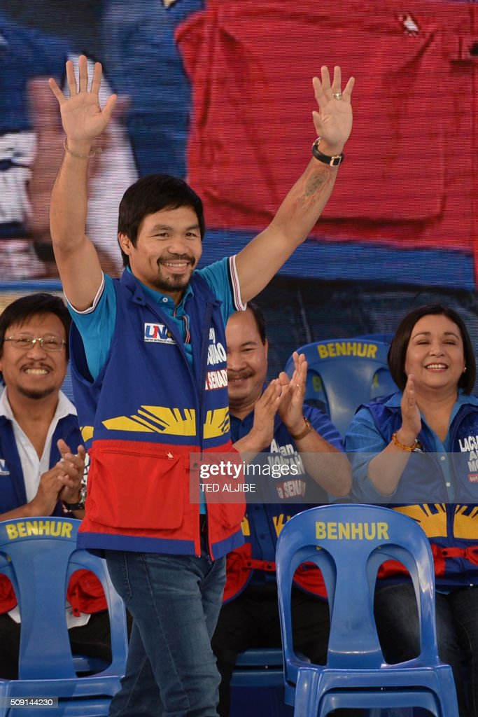 Senatorial candidate of the opposition party and boxing icon Manny Pacquiao greets supporters during his party's proclamation rally in Manila on February 9, 2016. A cliffhanger race to lead the Philippines began February 9 with the adopted daughter of a dead movie star and a tough-talking politician who claims to kill criminals among the top contenders. AFP PHOTO / TED ALJIBE / AFP / TED ALJIBE