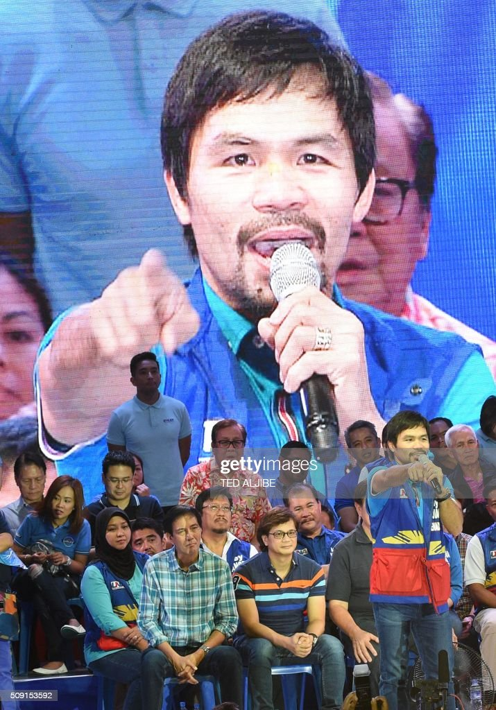 Senatorial candidate of the opposition party and boxing icon Manny Pacquiao speaks during their proclamation rally in Manila on February 9, 2016. A cliffhanger race to lead the Philippines began February 9 with emotion-charged rallies by a dead movie star's adopted daughter, a politician who brags about killing criminals and other top contenders. AFP PHOTO / TED ALJIBE / AFP / TED ALJIBE