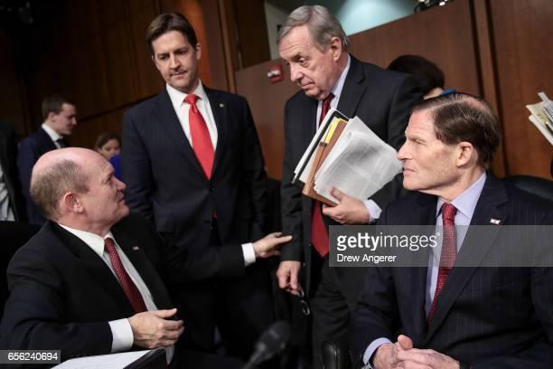 Senators Chris Coons Ben Sasse Dick Durbin and Richard Blumenthal speak with each other during a break in Judge Neil Gorsuch's Supreme Court...