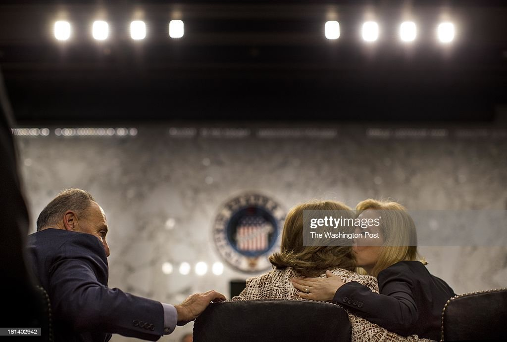 Senators Chuck Schumer (D-NY) and Kirsten Gillibrand (D-NY) congratulate Caroline Kennedy during the Senate Foreign Relations Committee hearing to decide her nomination for ambassador to Japan, on Capitol Hill Thursday September 19, 2013.