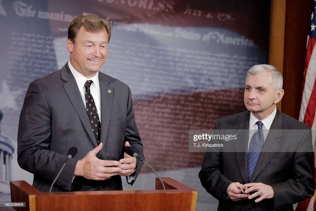 Senators Dean Heller (R-NV), left, and <a gi-track='captionPersonalityLinkClicked' href=/galleries/search?phrase=Jack+Reed+-+Politician&family=editorial&specificpeople=534274 ng-click='$event.stopPropagation()'>Jack Reed</a> (D-RI) speak to the press after a 61-35 vote in the Senate to advance the Reed-Heller bill on April 3, 2014 in Washington, DC. The bill, now expected to pass the Senate on Monday, would reinstate emergency unemployment insurance benefits for five months.