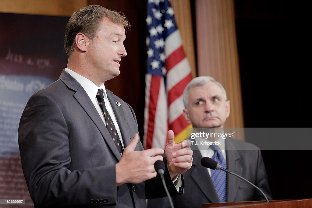 Senators Dean Heller (R-NV), left, and Jack Reed (D-RI) speak to the press after a 61-35 vote in the Senate to advance the Reed-Heller bill on April 3, 2014 in Washington, DC. The bill, now expected to pass the Senate on Monday, would reinstate emergency unemployment insurance benefits for five months.