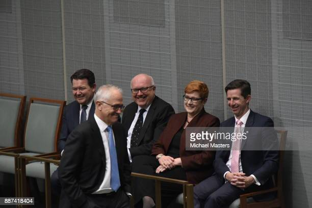 Senators Dean Smith George Brandis Marise Payne and Simon Birmigham speak with the Prime Minister Malcolm Turnbull before the final vote to legalise...