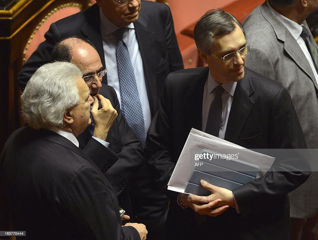 Senators Denis Verdini, former senate president Renato Schifani, and senator Niccola Ghedini chat during the first session of the senate on March 15, 2013 in Rome. General election in Italy took place on February 26 but as a majority in both chambers of parliament is required to form a government, Italy is left in a state of limbo with a hung parliament that is unprecedented in its post-war history.