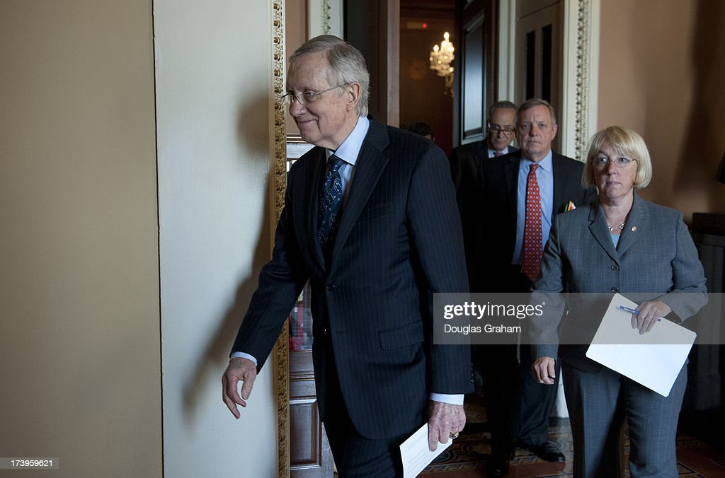 U.S. Senators Harry Reid (D-NV), Chuck Schumer (D-NY), Durbin (D-IL), and Patty Murray (D-WA), walk to a media availability to discuss the need to move forward with a House-Senate conference on the Budget Resolution and to allow our nations appropriations process to progress in regular order in the U.S. Capitol on July 18, 2013.