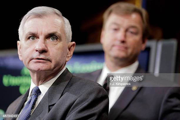 Senators Jack Reed left and Dean Heller speak to the press after a 6135 vote in the Senate to advance the ReedHeller bill on April 3 2014 in...