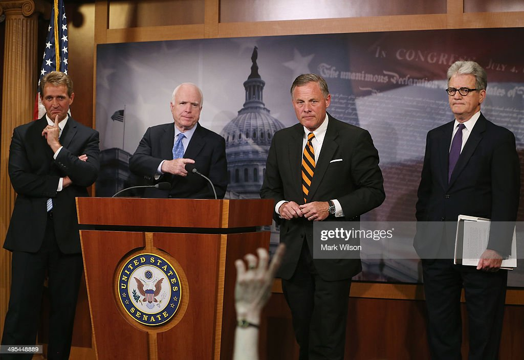 Senators Jeff Flake (R-AZ), John McCain (R-AZ), Richard Burr (R-NC) and Tom Coburn (R-OK) participate in a news conference about veterans affairs on Capitol Hill, June 3, 2014 in Washington, DC. The four Senators introduced The Veterans Choice Act, which addresses issues raised by the scandal at the U.S. Department of Veterans Affairs, and provides veterans with greater flexibility and choice in health care providers and increasing accountability and transparency at the Veterans Affairs administration.
