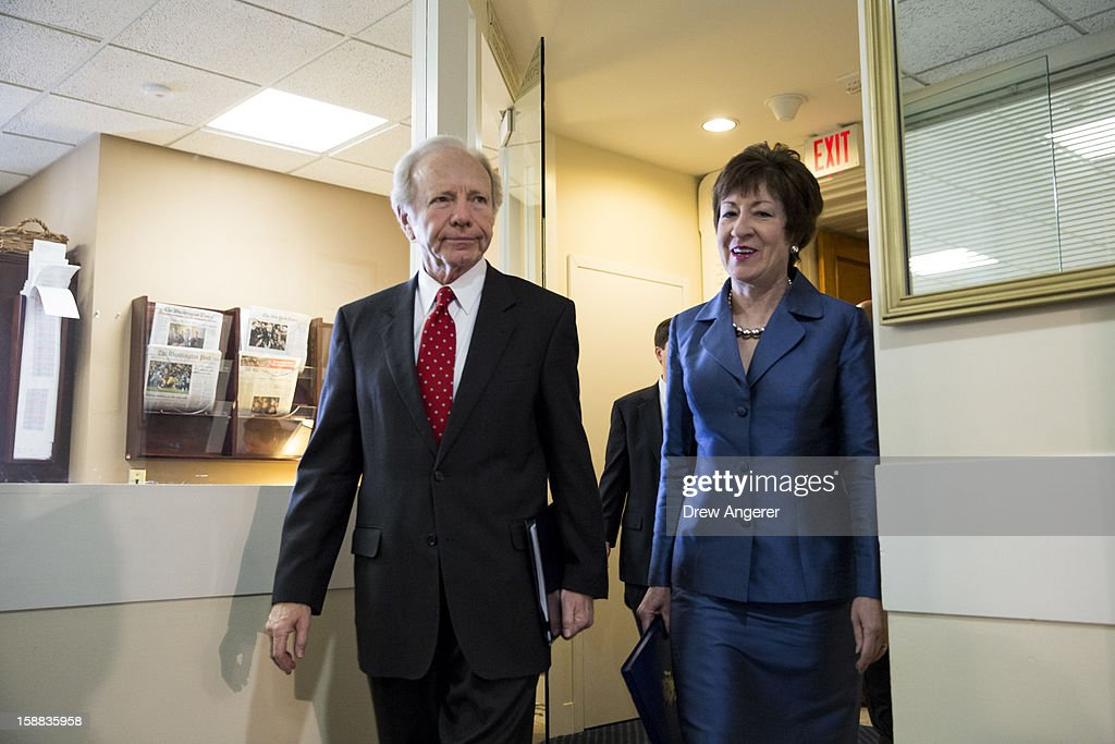 U.S. Senators Joe Lieberman (I-CT) and <a gi-track='captionPersonalityLinkClicked' href=/galleries/search?phrase=Susan+Collins+-+Politician&family=editorial&specificpeople=212962 ng-click='$event.stopPropagation()'>Susan Collins</a> (R-ME) arrive for a press conference about their report on the Benghazi consulate attack, on Capitol Hill, on December 31, 2012 in Washington, DC. The report was released on Monday by the Senate Committee on Homeland Security and Government Affairs and cites 'extremely poor security in a threat environment.'
