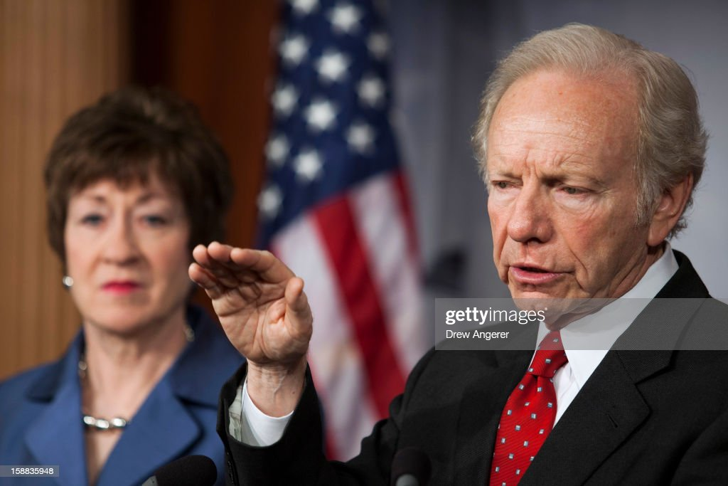 U.S. Senators Joe Lieberman (I-CT) (R) and <a gi-track='captionPersonalityLinkClicked' href=/galleries/search?phrase=Susan+Collins+-+Politician&family=editorial&specificpeople=212962 ng-click='$event.stopPropagation()'>Susan Collins</a> (R-ME) (L) hold a press conference about their report on the Benghazi consulate attack, on Capitol Hill, on December 31, 2012 in Washington, DC. The report was released on Monday by the Senate Committee on Homeland Security and Government Affairs and cites 'extremely poor security in a threat environment.'