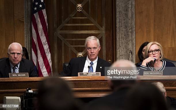 WASHINGTON DC Senators John McCain left questions General John Kelly during a confirmation hearing at the Senate Homeland Security Committee for the...
