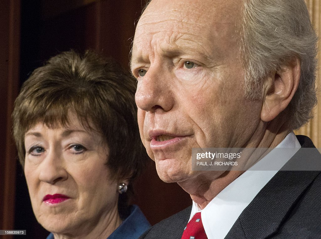 US Senators Joseph Lieberman(R), I-CT, Chairman, and Susan Collins(L),R-ME, Ranking Member, both of the US Senate Committee on Homeland Security and Governmental Affairs deliver remarks to the media December 31, 2012, regarding the investigative report, ' Flashing Red: A Special Report On The Terrorist Attack At Benghazi.' The scathing report faults the US State Department for failing to provide security in light of mounting threats leading up to the assault. The report says the facility was woefully under-protected at a time when the region, according to a top department official, was 'flashing red' yet, security was not improved and there was no recommendation to close the compound. The report also placed fault with the White House and the Pentagon. AFP PHOTO/Paul J. Richards