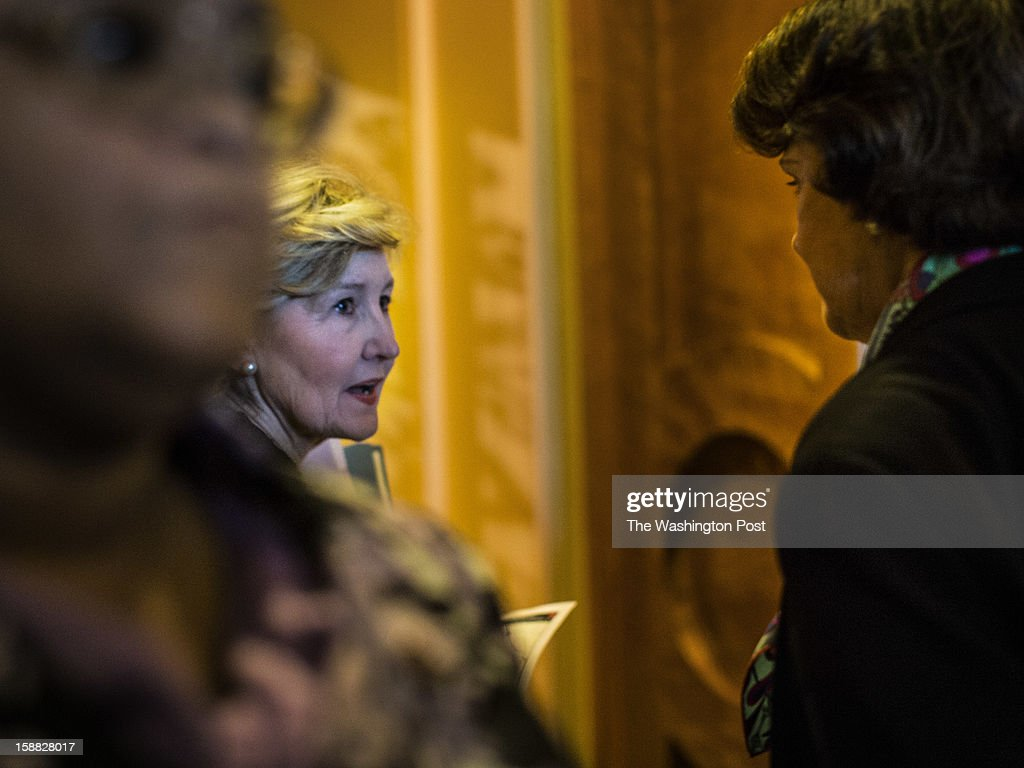 Senators Kay Bailey Hutchison (R-TX) and Dianne Feinstein (D-CA) rush onto the Senate floor for a vote on a rare Sunday session to consider a possible deal crafted on Saturday behind the scenes to prevent a dive off the 'fiscal cliff', on Capitol Hill, Sunday, December 30, 2012.