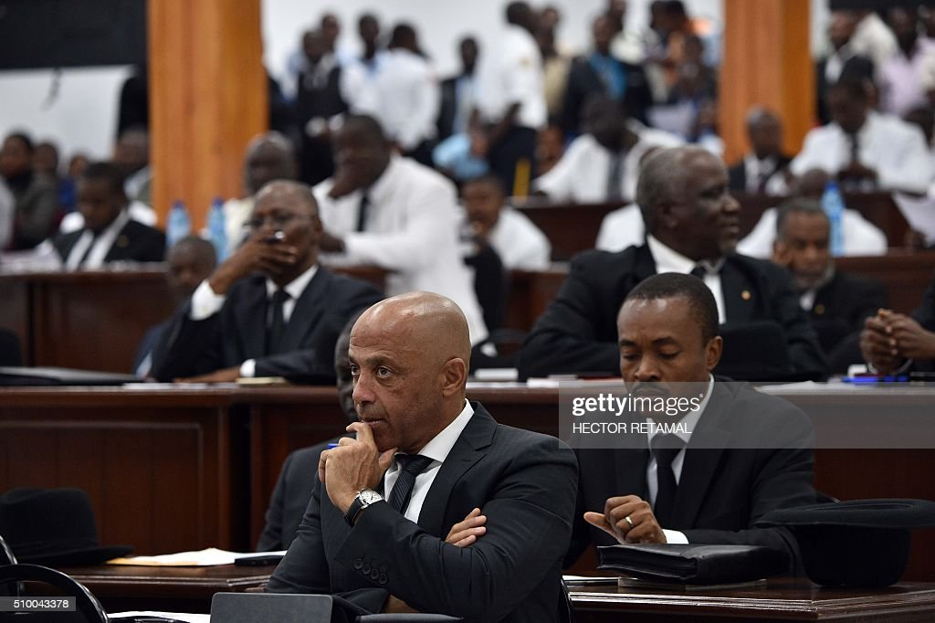 Senators listen prior to the election of a provisional president at the National Assambly in the Haitian Parliament in Port-au-Prince, on February 13, 2016. Haitian lawmakers were set to elect an interim president to fill the power vacuum following the departure of Michel Martelly, after a vote to choose his replacement was postponed over fears of violence. / AFP / HECTOR RETAMAL