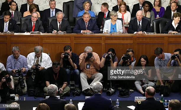 S Senators listen to the testimony of US Secretary of State John Kerry US Defense Secretary Chuck Hagel and US Chairman of the Joint Chiefs of Staff...