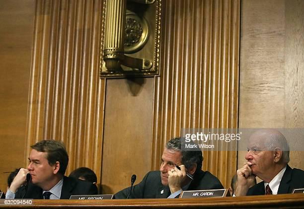 Senators Michael Bennet Sherrod Brown and Ben Cardin listen to Treasury Secretary nominee Steven Mnuchin testify during his Senate Finance committee...