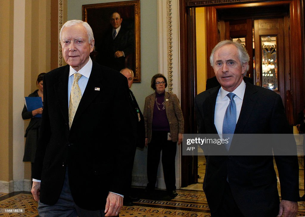 US Senators Orrin Hatch (L) and Bob Corker leave the Senate chamber to caucus in the US Capitol on December 30, 2012 in Washington, DC. Last minute talks stalled Sunday between top US political leaders aimed at averting a fiscal calamity due to hit within hours, as Democrats and Republicans blamed each other for a lack of progress. Top Democrats and Republicans groped for a compromise before a punishing package of government spending cuts and tax hikes come into force on January 1 which could roil global markets and send the US economy back into recession. AFP PHOTO/Molly RILEY