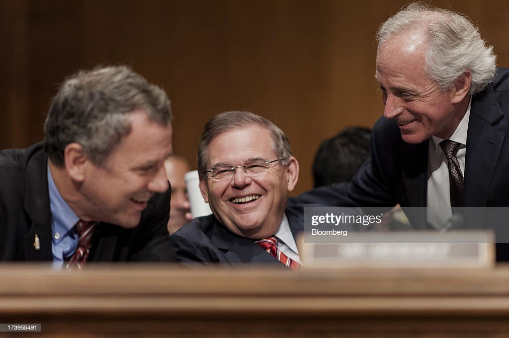 Senators Sherrod Brown, a Democrat from Ohio, from left, Robert Menendez, a Democrat from New Jersey, and Bob Corker, a Republican from Tennessee, laugh while chatting before the start of the Senate Banking, Housing, and Urban Affairs Committee hearing with Ben S. Bernanke, chairman of the U.S. Federal Reserve, not seen, in Washington, D.C., U.S., on Thursday, July 18, 2013. Bernanke said one reason for the recent rise in long-term interest rates is the unwinding of leveraged and 'excessively risky' investing. Photographer: Pete Marovich/Bloomberg via Getty Images