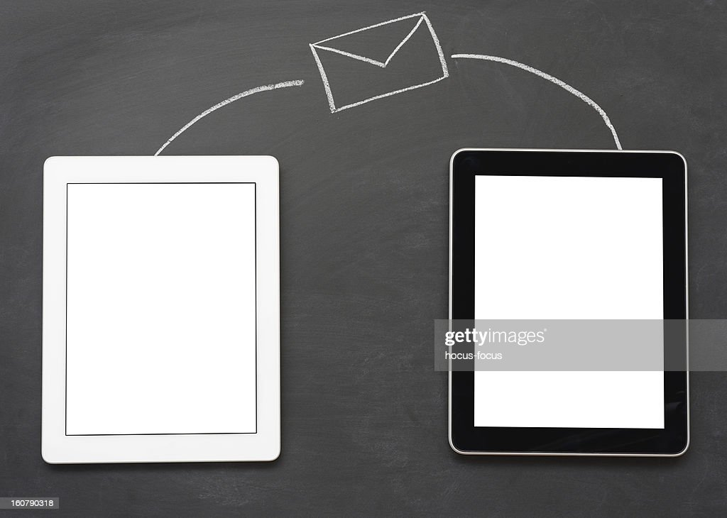 Sending messages with tablet computers : Stock Photo