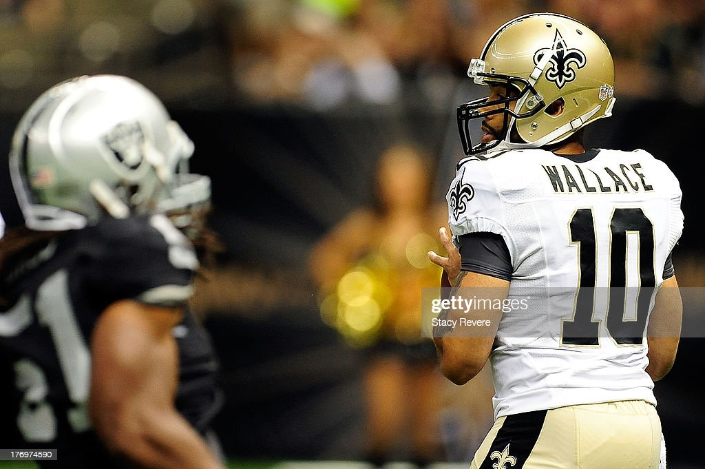 Seneca Wallace #10 of the New Orleans Saints looks for an open receiver during a preseason game against the Oakland Raiders at the Mercedes-Benz Superdome on August 16, 2013 in New Orleans, Louisiana. The Saints won 28-20.