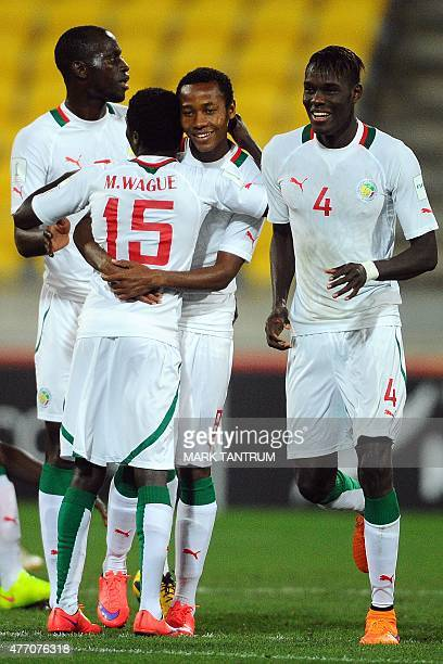 Senegal players celebrate their victory in the FIFA Under20 World Cup football quarterfinal match between Senegal and Uzbekistan in Wellington on...