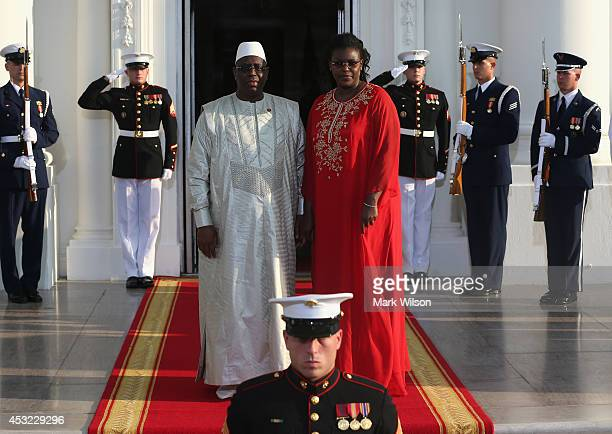 Senegal President Macky Sall and spouse Marieme Sall arrive at the North Portico of the White House for a State Dinner on the occasion of the US...