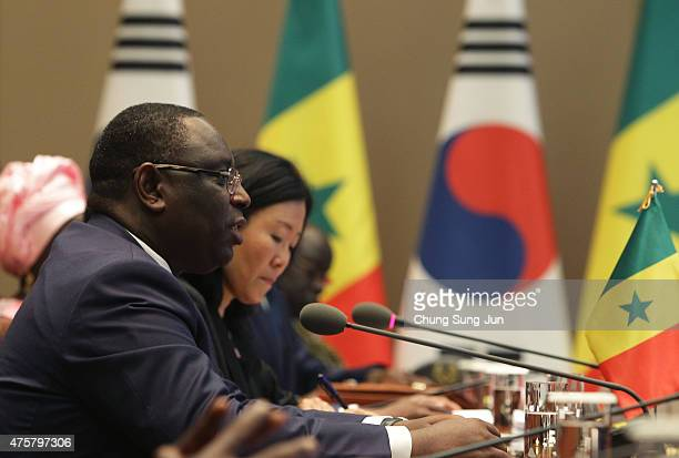 Senegal President Macky Sall talks with South Korean President Park GeunHye during their meeting at the presidential blue house on June 4 2015 in...