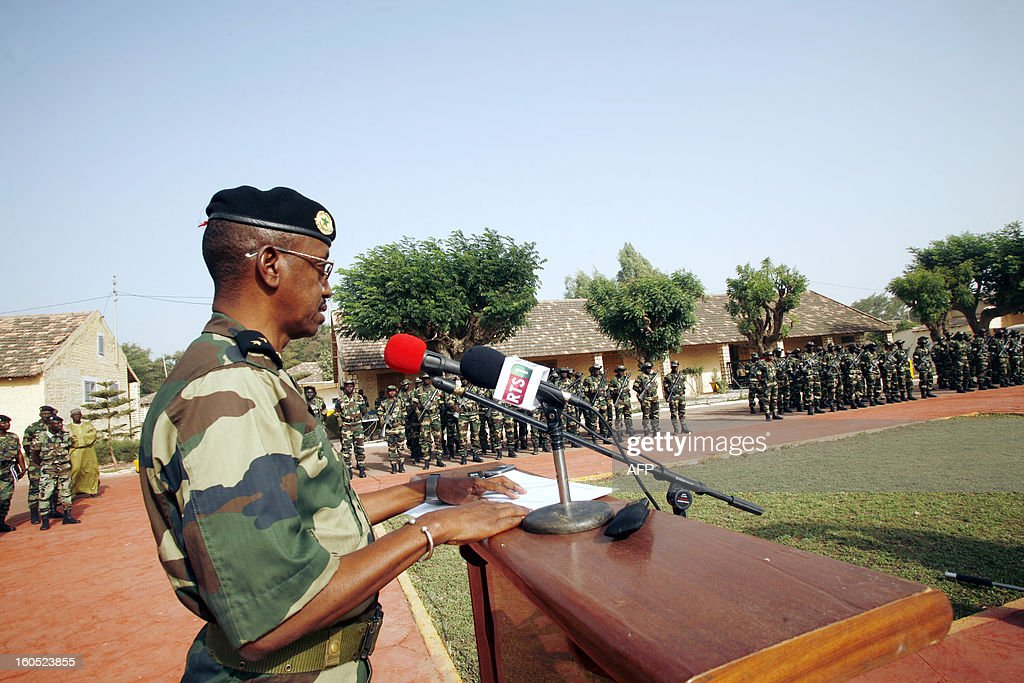 Senegalese army chief, General Mamadou Sow (foreground) delivers a speech after reviewing the troops in the Captain Moussa Dioum military camp of Bargny, near Dakar, on February 2, 2013 in Dakar, before their departure for Mali as part of the second contingent of Senegalese troops to back Malian forces. President Francois Hollande arrived in Mali Saturday to push for African troops to replace French forces who led a lightning advance that drove back radical Islamists from the country's desert north. BEHAN