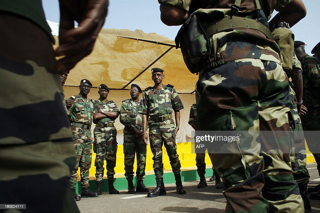 Senegalese army chief, General Mamadou Sow (C) reviews the troops in the Captain Moussa Dioum military camp of Bargny, near Dakar, on February 2, 2013 in Dakar, before their departure for Mali as part of the second contingent of Senegalese troops to back Malian forces. President Francois Hollande arrived in Mali Saturday to push for African troops to replace French forces who led a lightning advance that drove back radical Islamists from the country's desert north. BEHAN