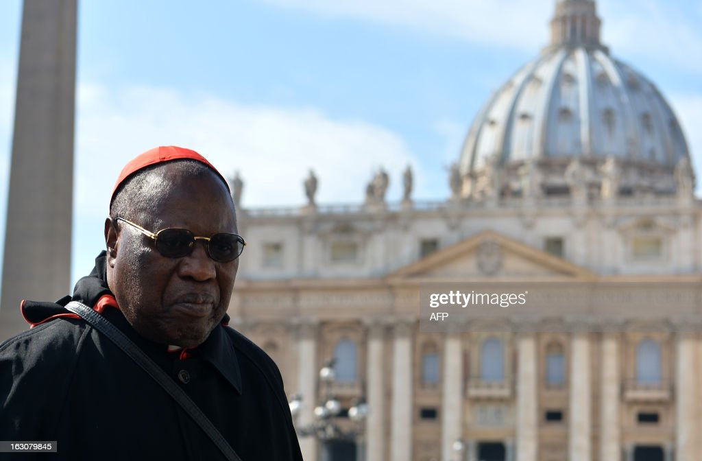 Senegalese Cardinal Theodore Adrien Sarr walks during a break of a meeting of a conclave to elect a new pope on March 4, 2013 at the Vatican. The Vatican meetings will set the date for the start of the conclave this month and help identify candidates among the cardinals to be the next leader of the world's 1.2 billion Catholics.