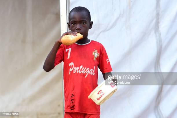 A Senegalese child stands in a street of Guediawaye near Dakar while begging for money or food on July 19 2017 Senegal's 'talibes' children as young...