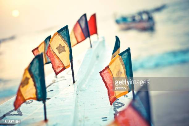 Senegalese flags on the boat.