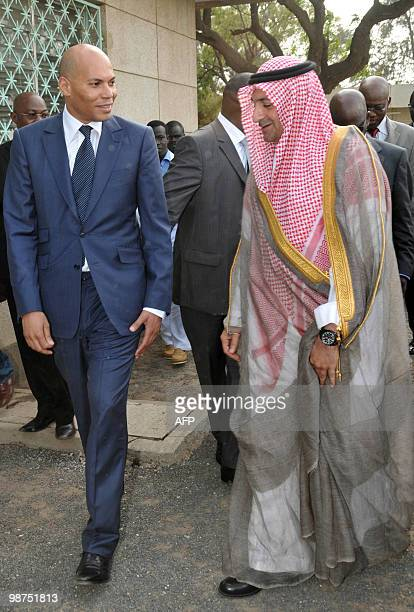Senegalese minister of state Karim Wade walks with Cheikh Saad Mohamed ben Laden vicepresident of Pcmc a subsidiary of Saudi Binladin group during a...