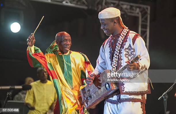 Senegalese musician Doudou N'Diaye Rose music group and Moroccan musician Mahmoud Guinia's group perform on the stage during 19th Annual Gnaoua Music...