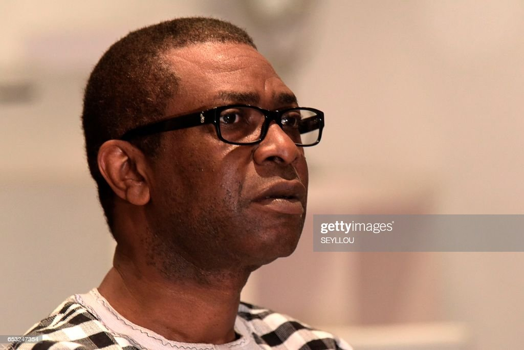Senegalese musician Youssou N'Dour looks on during an interview on March 13, 2017 at a restaurant in Dakar. /