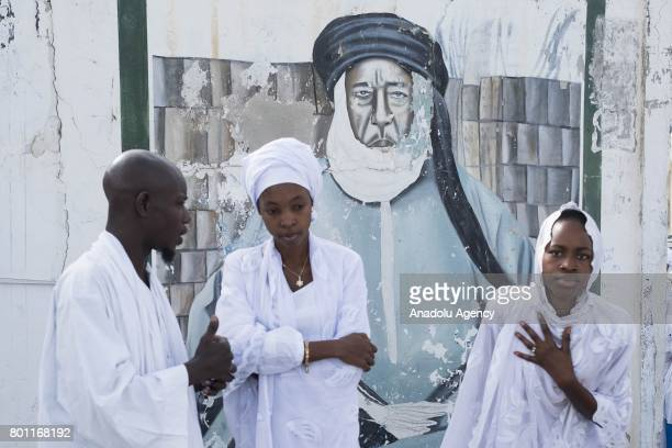 Senegalese Muslims gather Eid alFitr prayer at Mausolee de Seydina Limamou Mosque in Dakar Senegal on June 26 2017 Eid alFitr is a religious holiday...