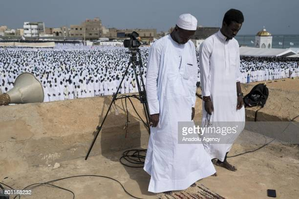 Senegalese Muslims perform Eid alFitr prayer at Mausolee de Seydina Limamou Mosque in Dakar Senegal on June 26 2017 Eid alFitr is a religious holiday...