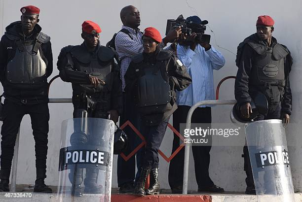 Senegalese policemen block access to the courthouse on March 23 2015 in Dakar during the trial of Karim Wade former Senegalese minister and son of...
