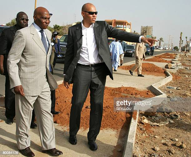 Senegalese President Abdoulaye Wade listens to his son Karim Wade President of the National Agency for Organising the Islamic Conference on March 2...
