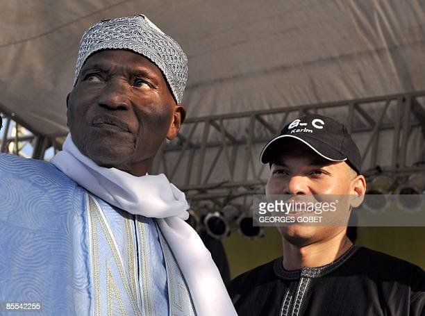 Senegalese President Abdoulaye Wade stands with his son Karim Wade on March 20 2009 at a campaign meeting for the municipal elections in the capital...