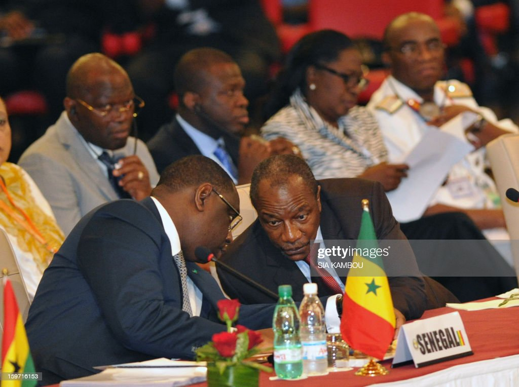 Senegalese President Macky Sal (L) and Guinea's President Alpha Conde (R) sit during the opening session of the regional bloc ECOWAS summit on expediting an African force to come to Mali's aid, on January 19, 2013 in Abidjan. Ivorian President and current head of the regional bloc ECOWAS, Alassane Ouattara today called for a broader international commitment to the military operations in Mali, where Malian and French forces are battling Islamist militant groups that control the country's vast arid north.