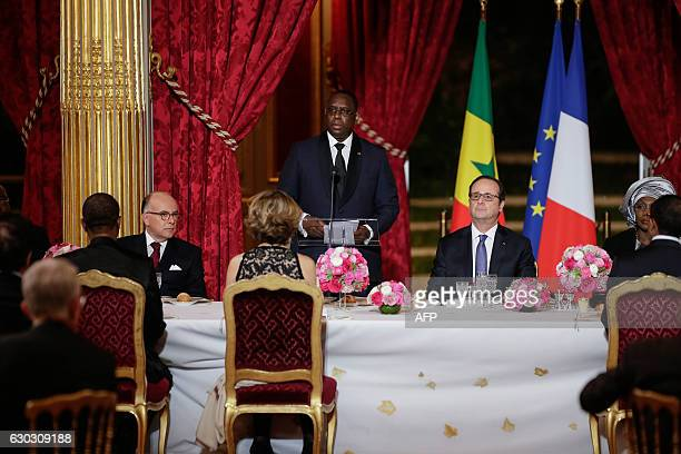 Senegalese President Macky Sall delivers a speech next to French President Francois Hollande during a state dinner at the Elysee Palace in Paris on...