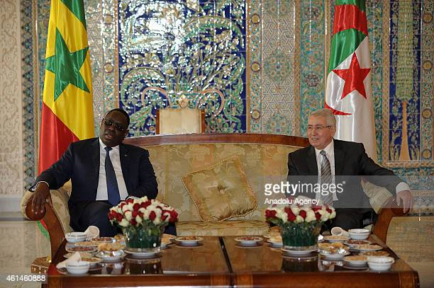 Senegalese President Macky Sall meets with Algeria's President of the Council of the Nation Abdelkader Bensalah upon his arrival in Algiers Algeria...