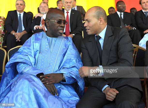 Senegalese Prime minister Souleymane Ndene Mbaye speaks with a minister of state Karim Wade on February 12 in Rufisque during the launch of the...