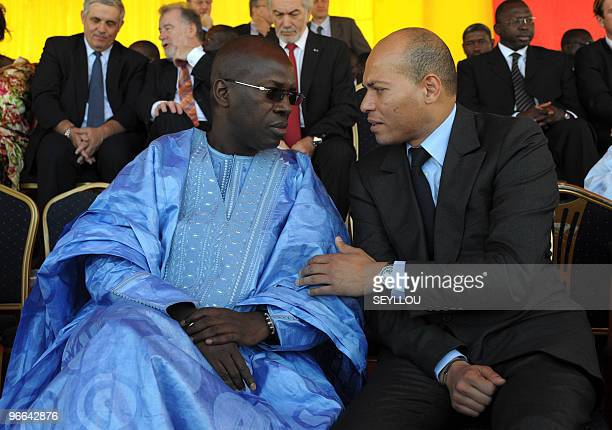 Senegalese Prime Minister Souleymane Ndene Mbaye speaks with Minister of State of Senegal Karim Wade on February 12 in Dakar during the launch of the...